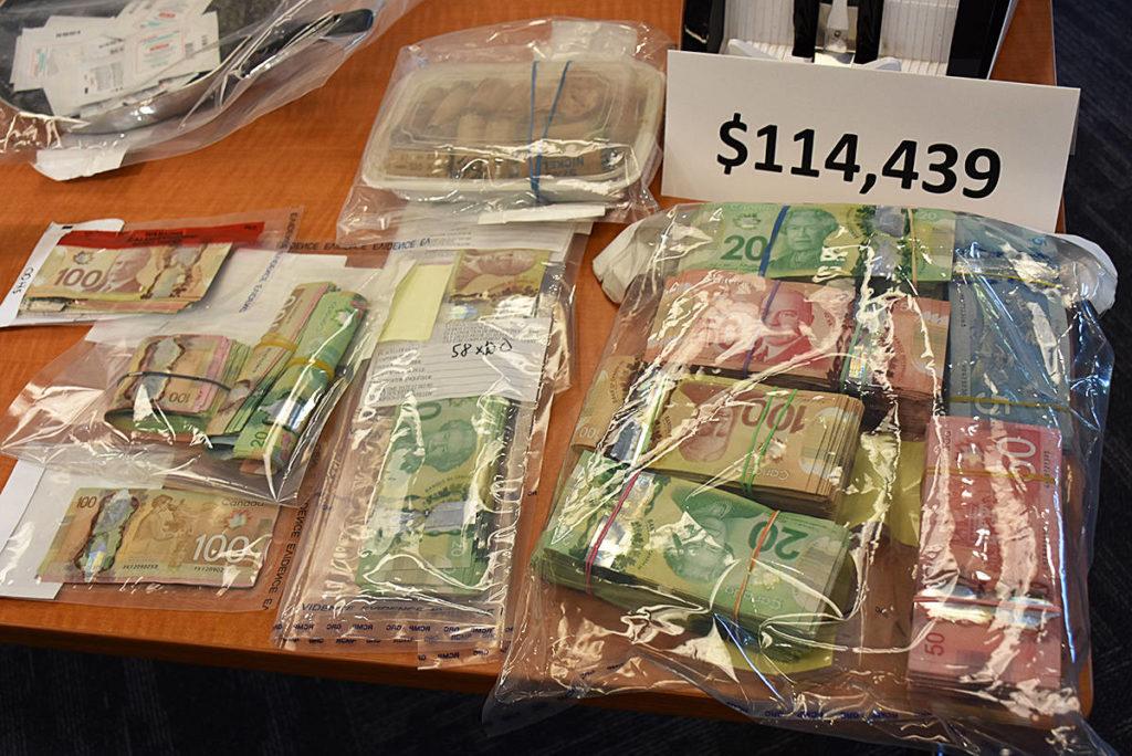 Police seized $114,000 in cash. (Neil Corbett/The News)