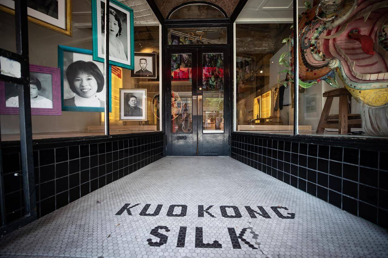"""The name of the former Kuo Kong Silk business that occupied the space is seen in tile outside the Chinese Canadian Museum of British Columbia's first exhibit, """"A Seat at the Table"""" in Chinatown in Vancouver, B.C., Wednesday, Aug. 12, 2020. THE CANADIAN PRESS/Darryl Dyck"""