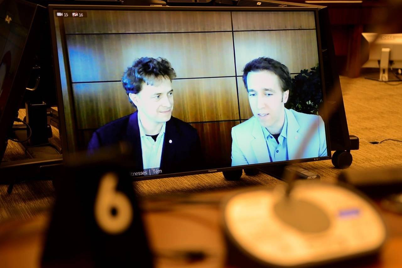 Marc Kielburger, screen left, and Craig Kielburger, screen right, appear as witnesses via videoconference during a House of Commons finance committee in the Wellington Building in Ottawa on Tuesday, July 28, 2020. THE CANADIAN PRESS/Sean Kilpatrick