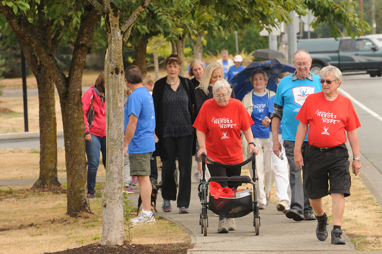 People take part in the Parkinson SuperWalk on Sept. 9, 2017 in Chilliwack, B.C. The 30th annual fundraiser for Parkinson Society British Columbia is going virtual this year on Sept. 12 and 13. (Jenna Hauck/ Chilliwack Progress file)