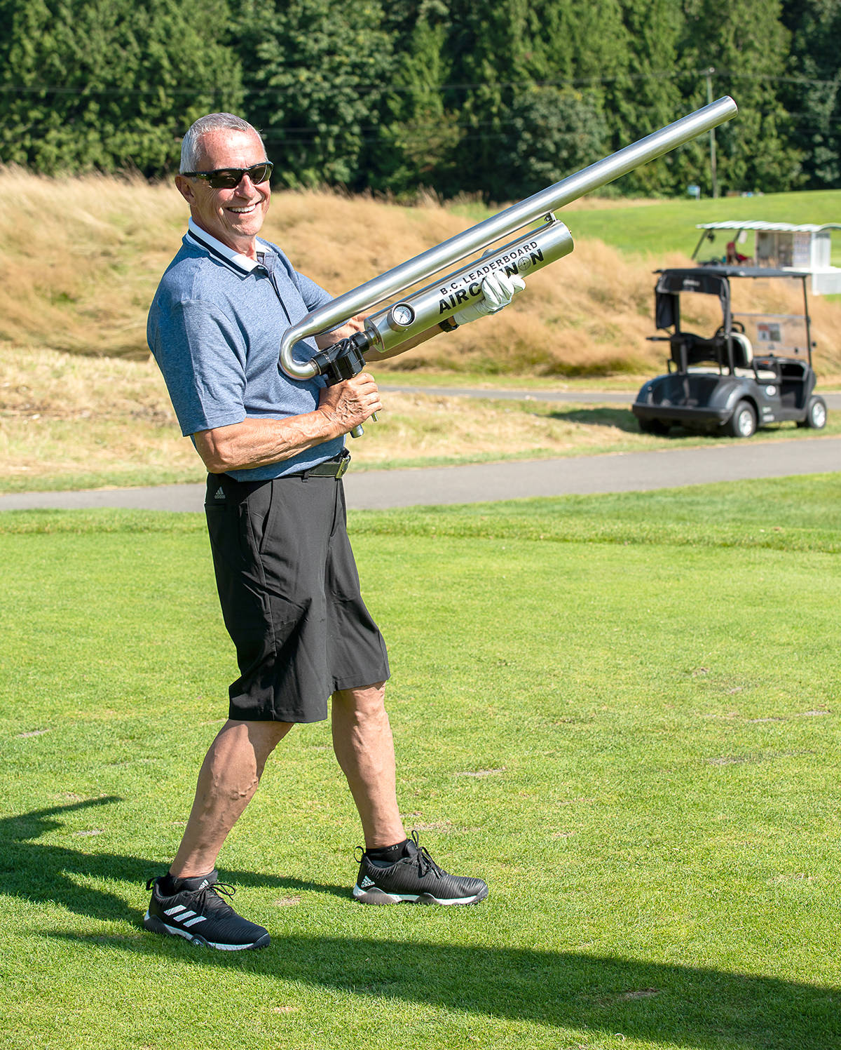 Peter Fassbender, on the hospital foundation board, tried ot the air cannon during the tournament. (CK Wright Photography/Special to the Langley Advance Times)