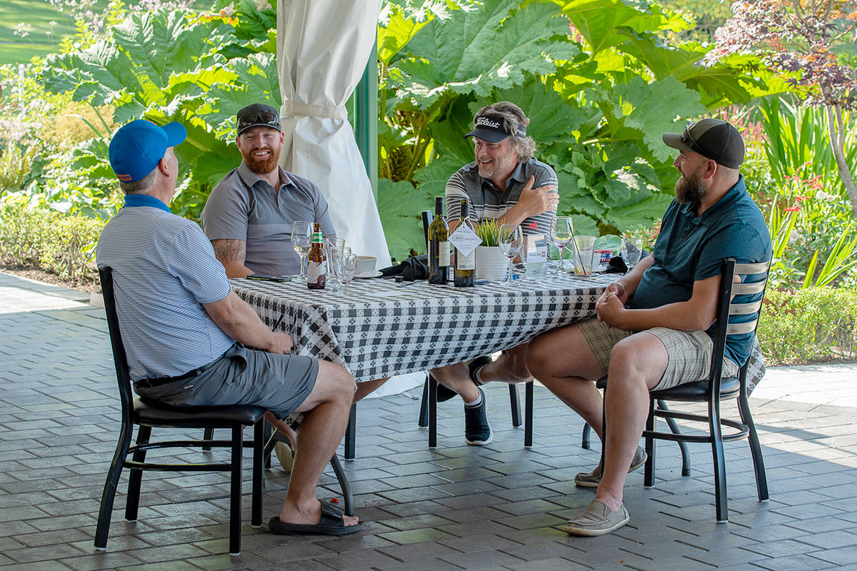 Mike Laurin (third from left) enjoyed dinner with his golf team after a full 18-hole game. (CK Wright Photography/Special to the Langley Advance Times)
