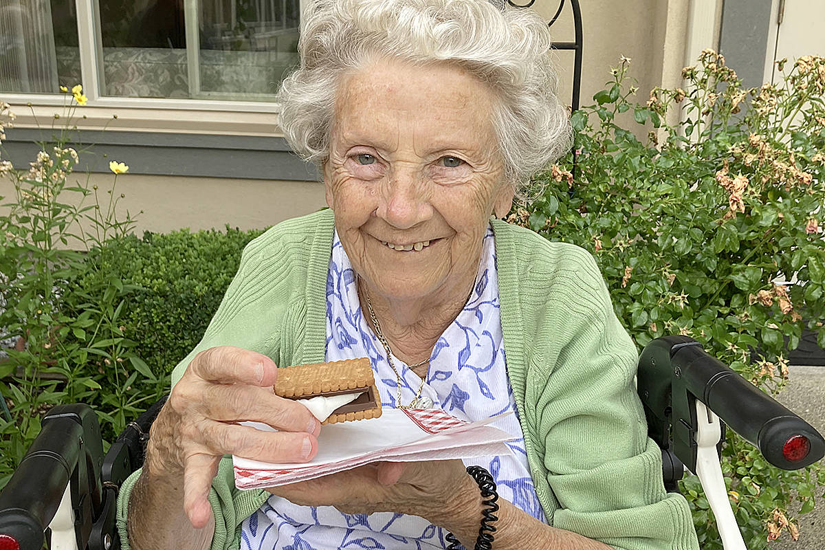 Ursula Gercken devoured a smore during the Chartwell Renaissance summer camp at the Langley residence. (Chartwell/Special to Langley Advance Times)