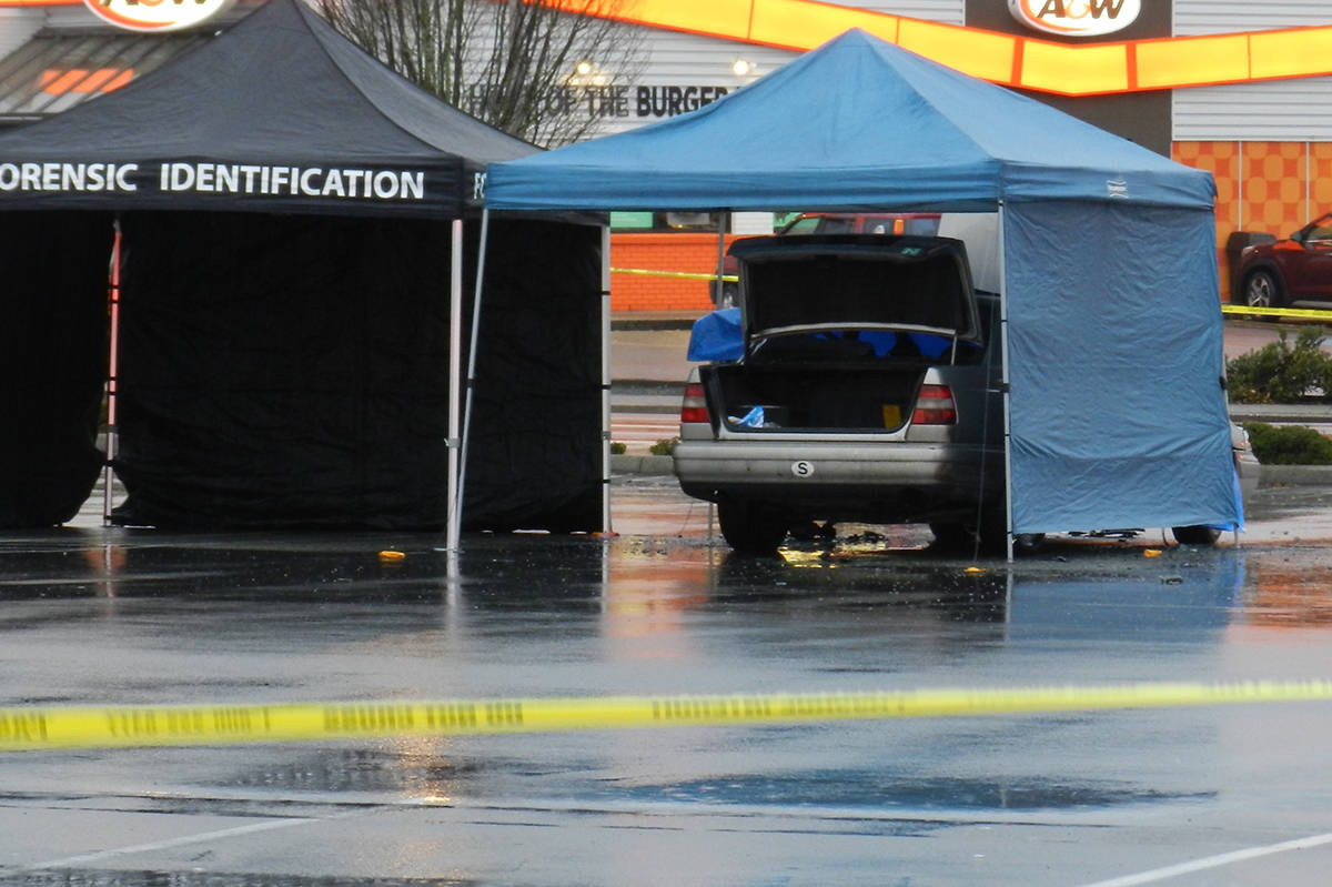 The RCMP Forensics Identification Unit was on the scene Friday morning after a car fire in the Safeway parking lot downtown Chilliwack.