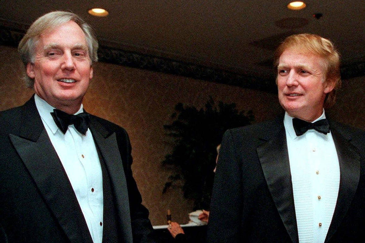 FILE - In this Nov. 3, 1999 file photo, Robert Trump, left, joins then real estate developer and presidential hopeful Donald Trump at an event in New York. (AP Photo/Diane Bonadreff, File)