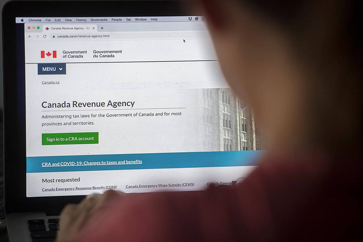 A person looks at a Canada Revenue Agency homepage in Montreal, Sunday, Aug. 16, 2020, as the COVID-19 pandemic continues in Canada and around the world. THE CANADIAN PRESS/Graham Hughes