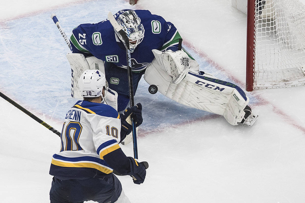 Vancouver Canucks goalie Jacob Markstrom (25) makes the save on St. Louis Blues' Brayden Schenn (10) during third period NHL Western Conference Stanley Cup playoff action in Edmonton, Sunday, Aug. 16, 2020. THE CANADIAN PRESS/Jason Franson
