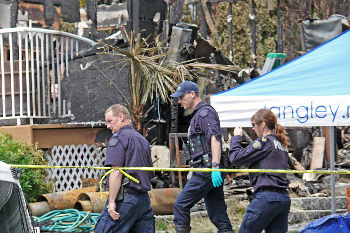 Investigators searched charred remains of a Langley house in the 19600 block of Wakefield Drive where three bodies were found on June 13, 2020. Kia Ebrahimian was later charged with three counts of second-degree murder. (Langley Advance Times files)