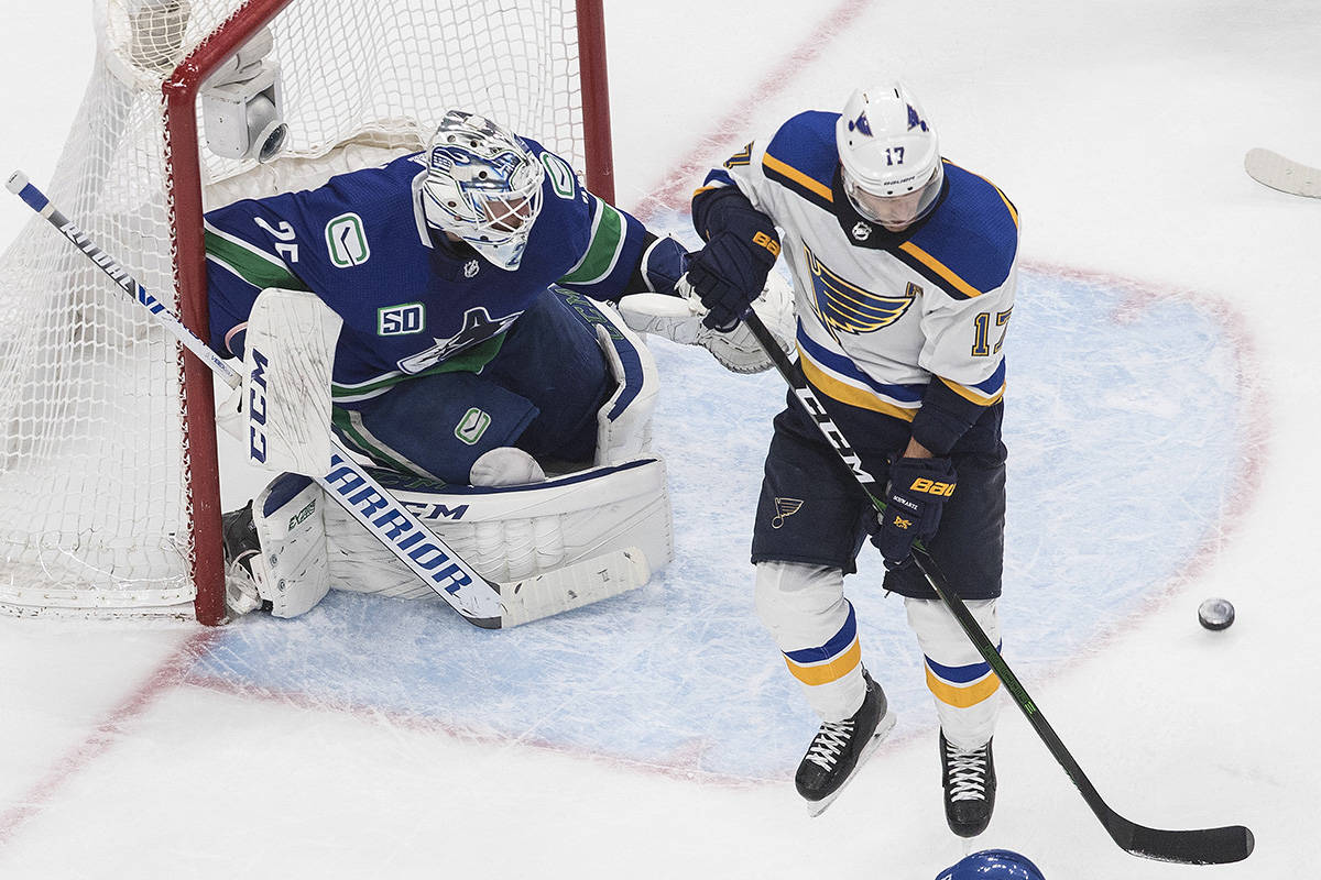 Vancouver Canucks goalie Jacob Markstrom (25) makes the save as St. Louis Blues' Jaden Schwartz (17) screens during second period NHL Western Conference Stanley Cup playoff action in Edmonton, Monday, Aug. 17, 2020. THE CANADIAN PRESS/Jason Franson