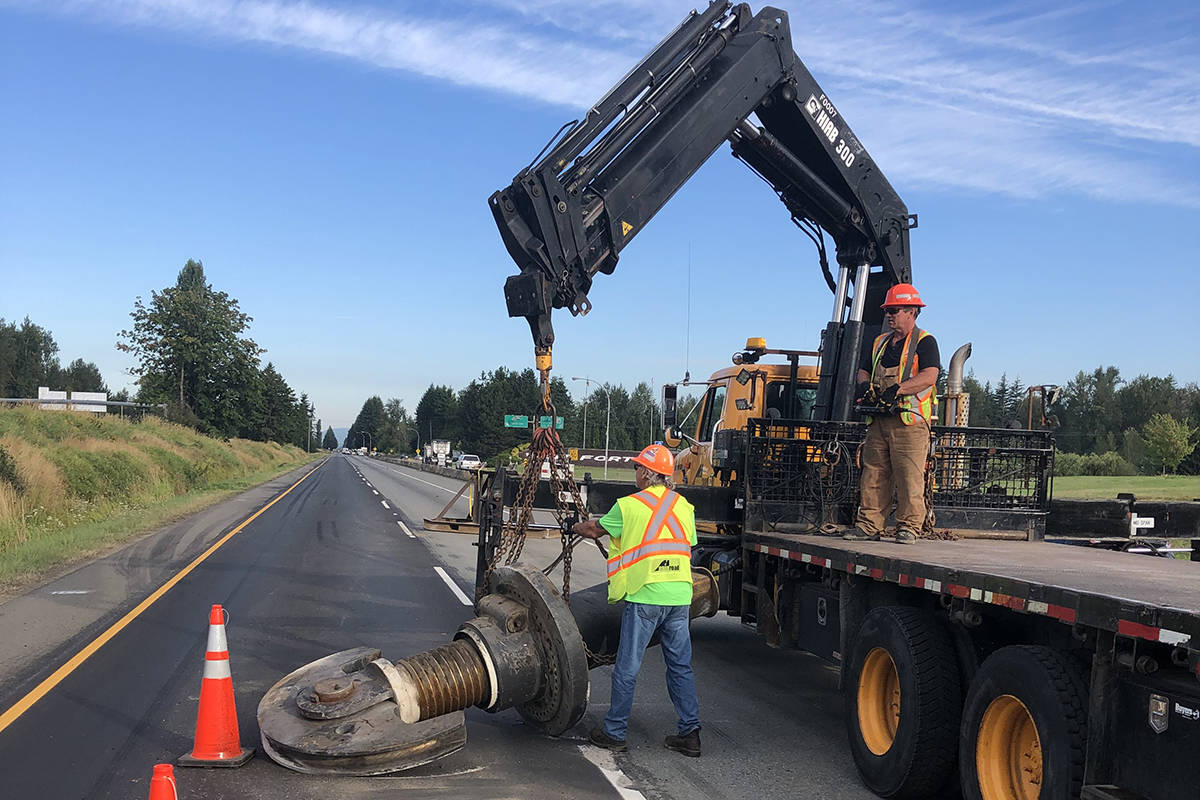 Crews from highway maintenance contractor Mainroad work to clear debris from Highway 1 at 264th Street in Langley that was blocking both westbound lanes Tuesday, Aug. 18, 2020. (MainroadLM photo)