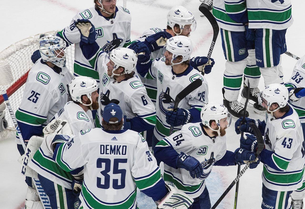 Vancouver Canucks celebrate the win over the St. Louis Blues during third period NHL Western Conference Stanley Cup playoff action in Edmonton on Wednesday, August 19, 2020. THE CANADIAN PRESS/Jason Franson