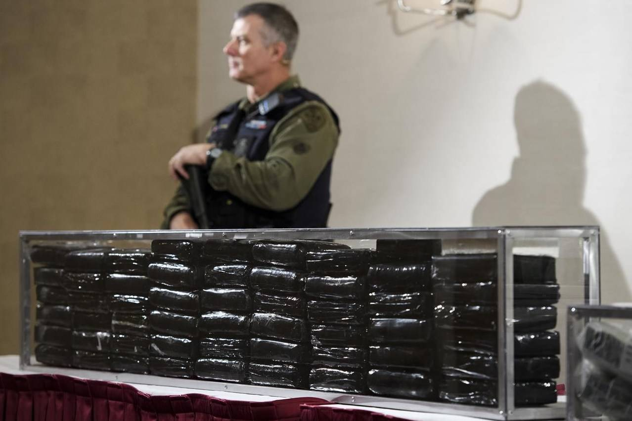 O.P.P officers guard 55 kilograms of cocaine during a press conference in Barrie, Ont., on Wednesday, April 3, 2019. Federal prosecutors are being instructed to criminally prosecute only the most serious drug possession offences and to find alternatives outside the criminal justice system for the rest. THE CANADIAN PRESS/Nathan Denette