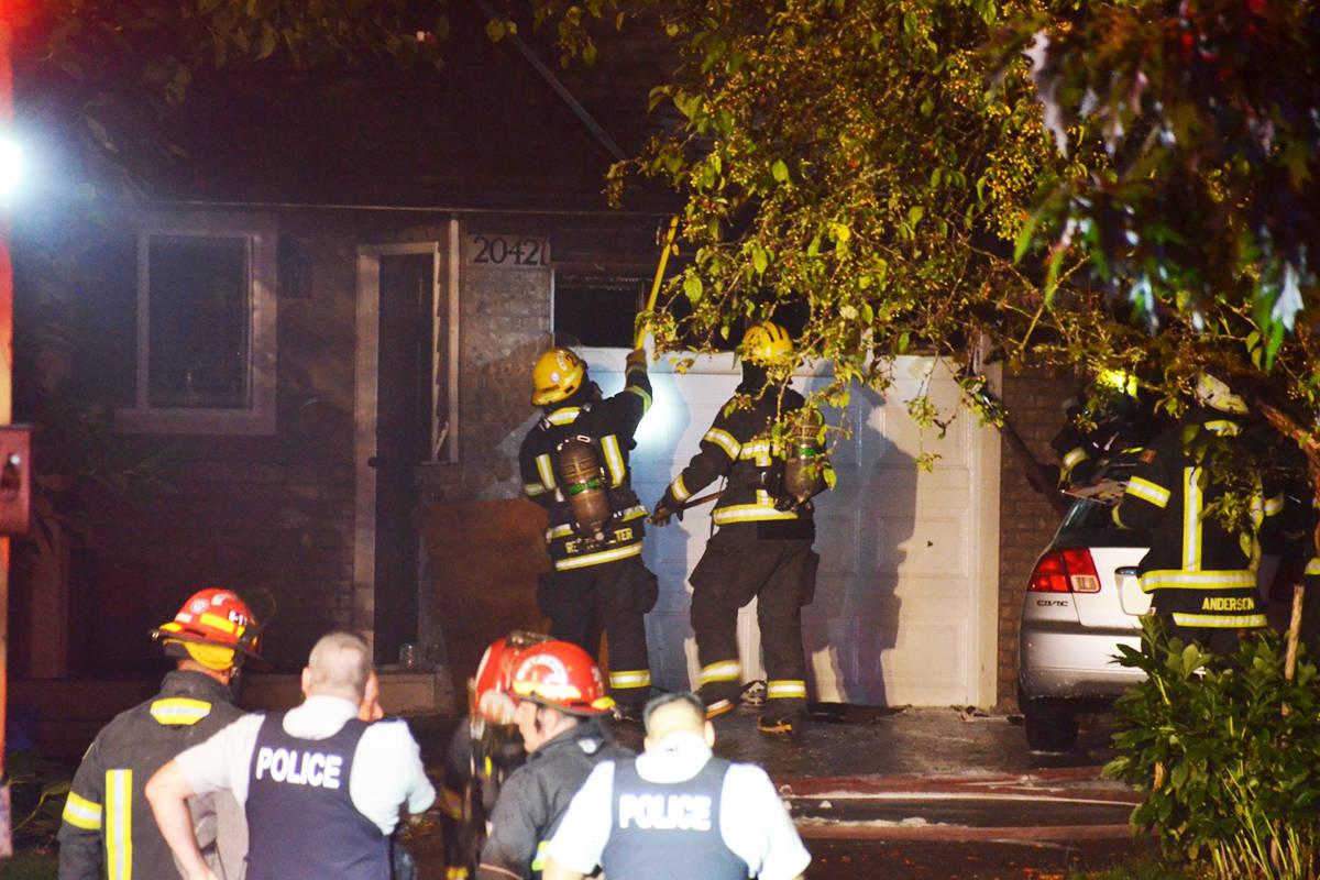 Township of Langley firefighters battle a blaze in the Walnut Grove neighbourhood on Thursday night. (Curtis Kreklau/ South Fraser News Services)