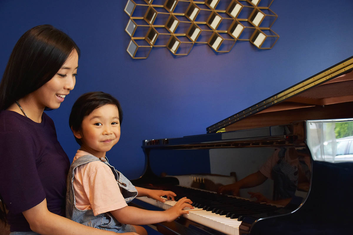 Lucas Yao and his mom, Cindy, sitting at the family's grand piano. (Ronan O'Doherty/ THE NEWS)