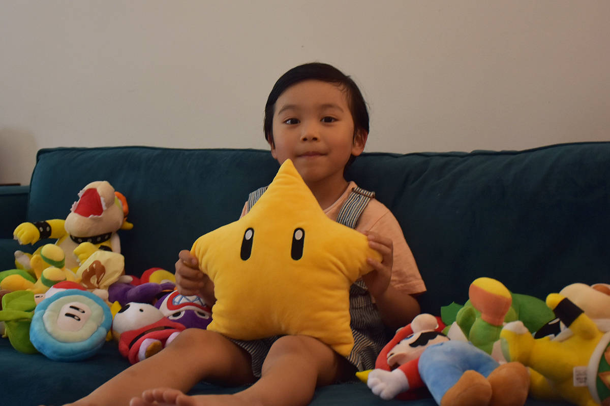 Lucas Yao has many collections. He is pictured with his plush Mario characters. His favourite - on the day this was taken - was the big star, which he will hopefully become some day. (Ronan O'Doherty/ THE NEWS)