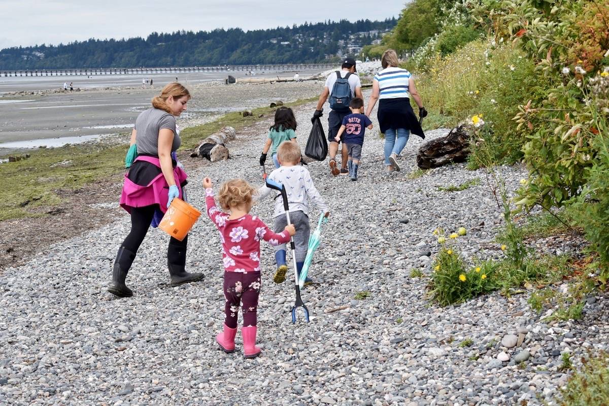 More than a dozen volunteers helped pick up garbage along East Beach Thursday (Aug. 20) morning, during a Great Canadian Shoreline Cleanup event organized by White Rock's Rachel Wurz (left). (Tracy Holmes photo)