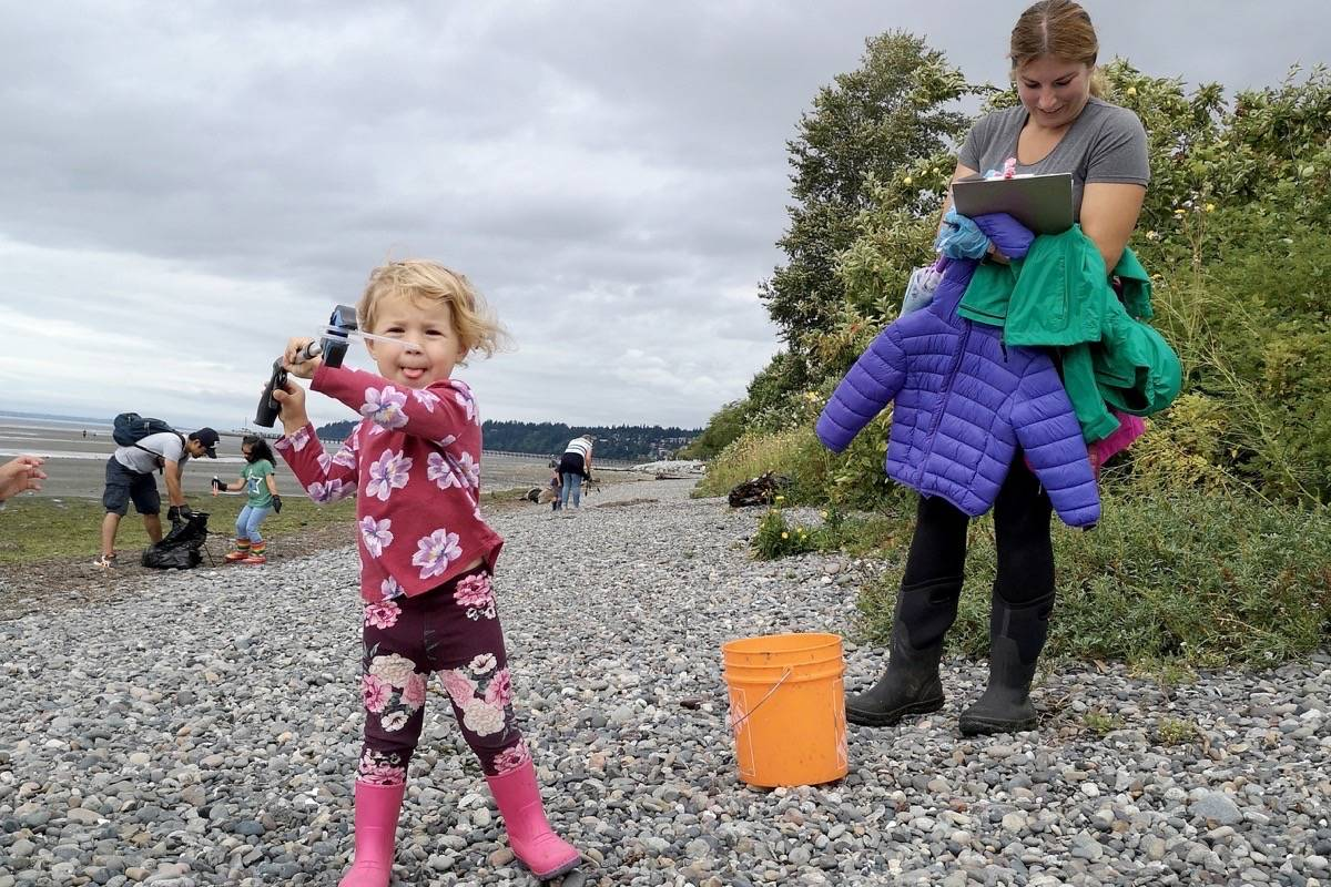 Leanna Wurz, 3, shows a plastic straw that she found on East Beach Thursday (Aug. 20) during a Great Canadian Shoreline Cleanup effort organized by her mom, Rachel. (Tracy Holmes photo)