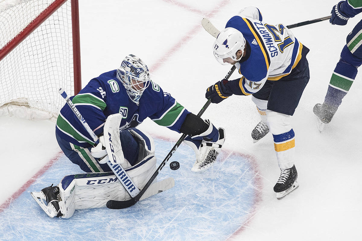 Vancouver Canucks goalie Jacob Markstrom (25) makes the save on St. Louis Blues' Jaden Schwartz (17) during first period NHL Western Conference Stanley Cup playoff action in Edmonton on Friday, Aug. 21, 2020. THE CANADIAN PRESS/Jason Franson