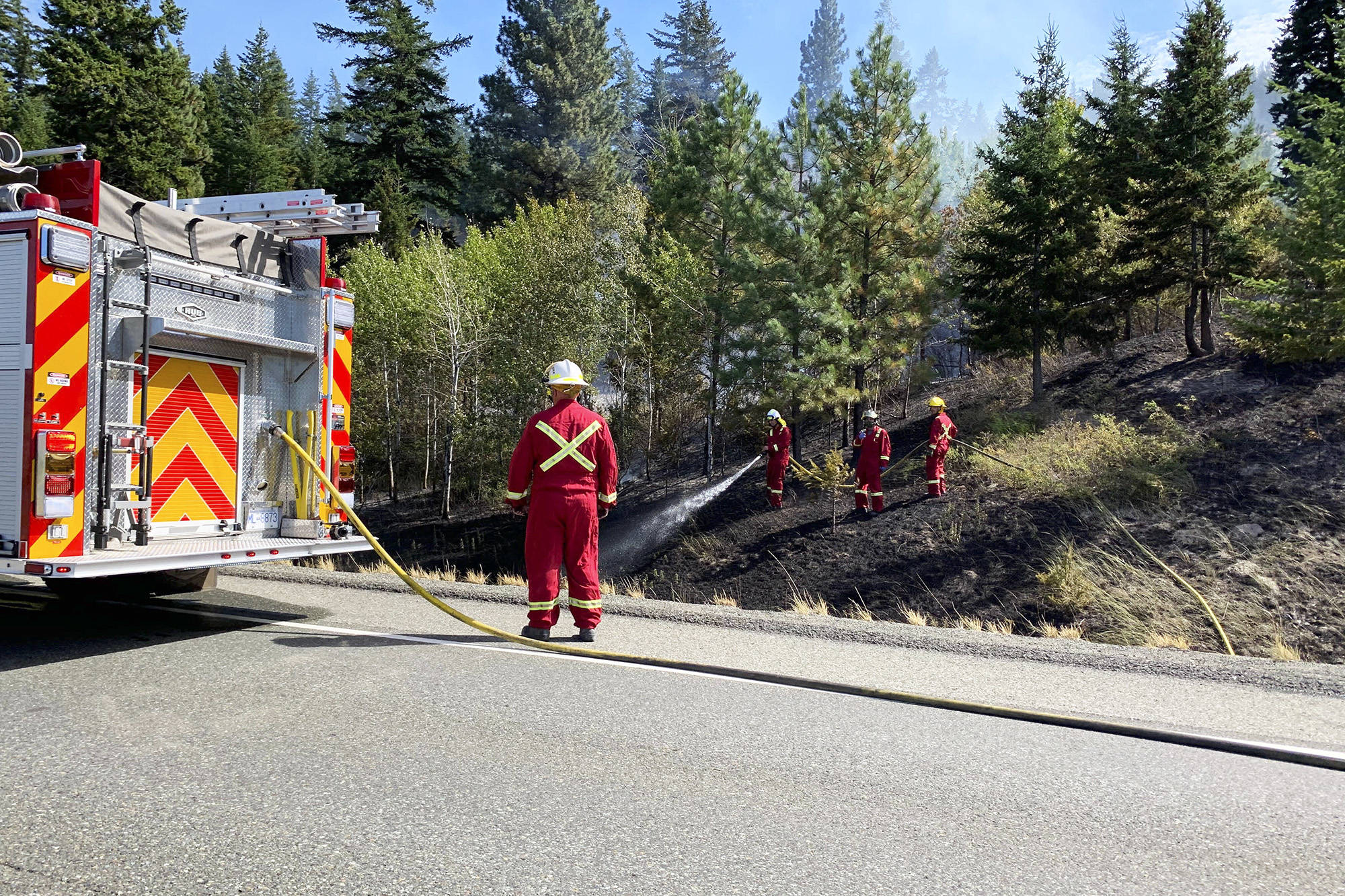 Fire crews from Merritt rushed to extinguish a fire by the Coquihalla Highway on Aug. 22 (Christian Peters Photo)