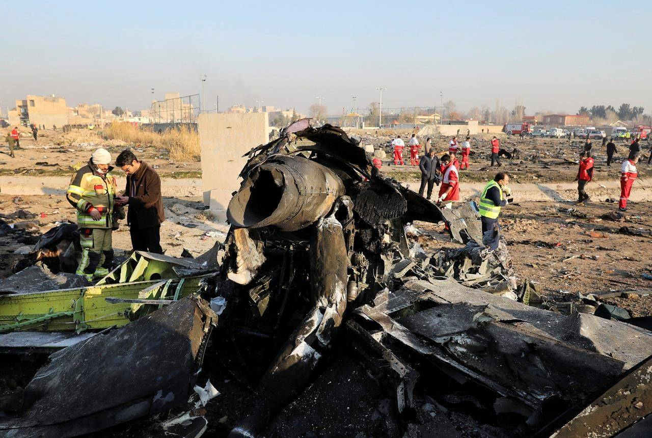 FILE - In this Jan. 8, 2020, file photo, debris at the scene where a Ukrainian plane crashed in Shahedshahr southwest of the capital Tehran, Iran. Iran has retrieved some data, including a portion of cockpit conversations, from the Ukrainian jetliner accidentally downed by the Revolutionary Guard forces in January, killing all 176 people on board, an Iranian official said Sunday, Aug. 23, 2020. (AP Photo/Ebrahim Noroozi, File)