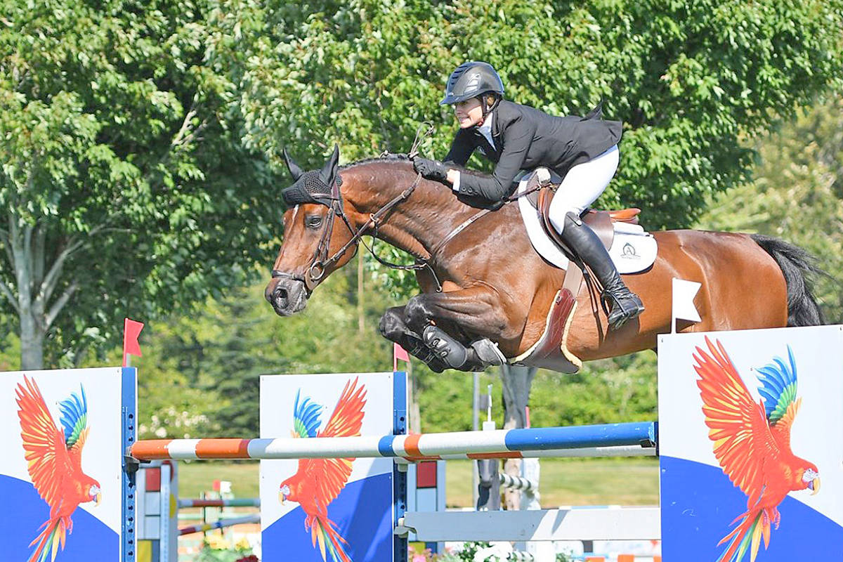 Langley's Tiffany Foster and Brighton won the $5,000 Maui Jim Welcome 1.45m at Thunderbird Show Park in the Fort Classic held on Friday, Aug. 14, 2020 . Competitive riding has resumed at the Langley facility, without spectators. (Totem Photographics/Special to Langley Advance Times)