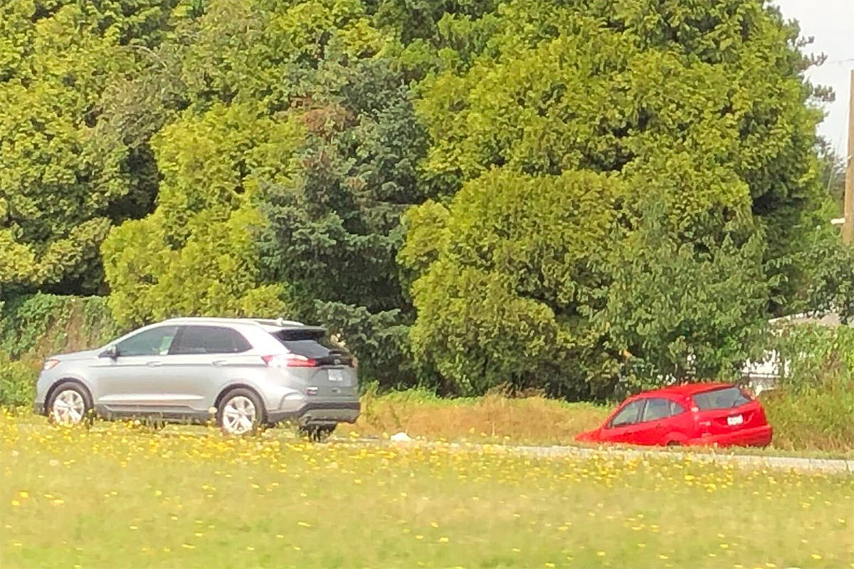 A vehicle landed in the ditch on Hwy 1 westbound near the Clearbrook overpass Sunday afternoon Aug. 23, 2020, tying up traffic. (Black Press Media)