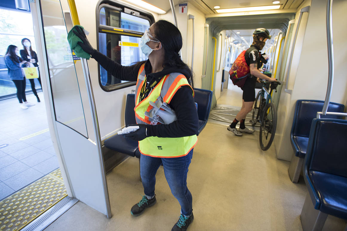 A cleaner demonstrates how they disinfect the train cars of the Sky Train in Vancouver, Thursday, May 21, 2020. Translink is working to try and provide a safe riding environment for their passengers during the COVID-19 pandemic. THE CANADIAN PRESS/Jonathan Hayward