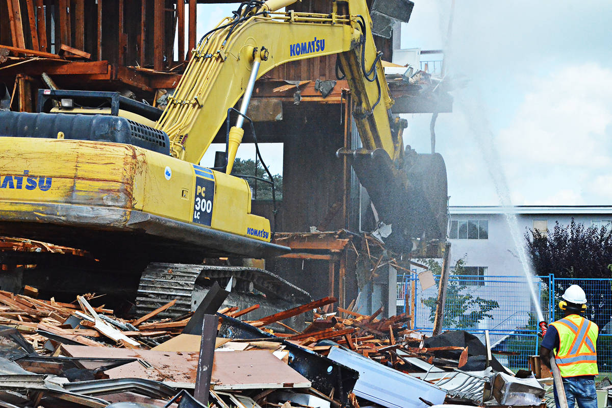 Demolition crews tore down the Villa Fontana apartment building in Langley City on Monday, Aug. 24, after fire damaged the building last November. (Matthew Claxton/Langley Advance Times)
