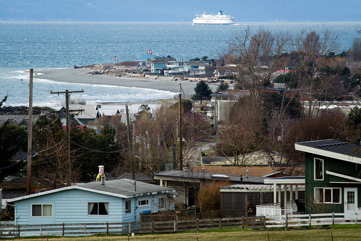 A BC Ferries vessel travels in the distance past Point Roberts, Wash., on Tuesday March 13, 2012. Point Roberts is part of the mainland United States but not physically connected to it, to reach the community by land one must pass through Canada. THE CANADIAN PRESS/Darryl Dyck