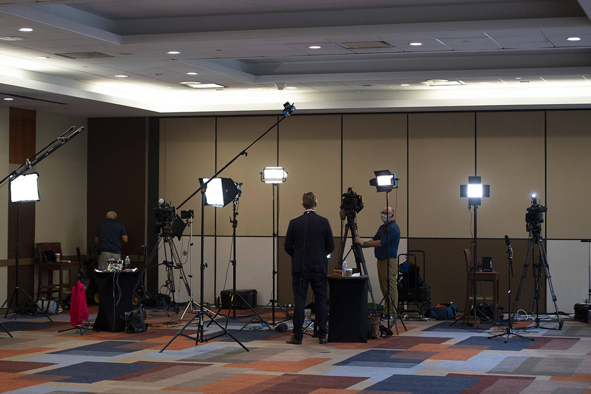 Television journalists work before the announcement of the new leader of the Conservative Party of Canada, in Ottawa on Sunday, Aug. 23, 2020. As many as 40 local television outlets and up to 200 Canadian radio stations could be forced to close in the next three years as the pandemic adds to financial pressures media companies were facing before COVID-19, according to a new study from a media advocacy group. THE CANADIAN PRESS/Justin Tang