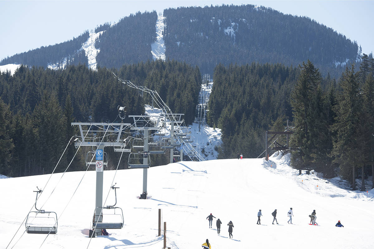 FILE – Children make their way up a closed Whistler Mountain to toboggan in Whistler, B.C. Sunday, March 15, 2020. THE CANADIAN PRESS/Jonathan Hayward
