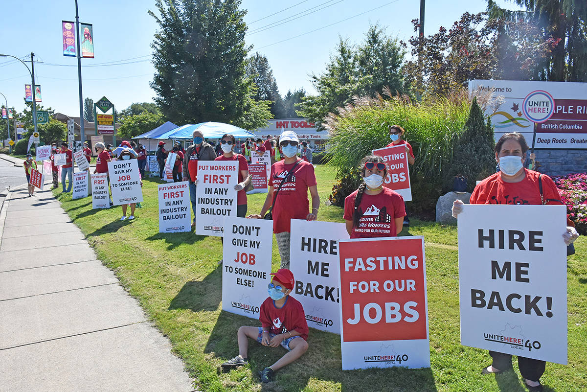 Laid off hotel workers demonstrate outside the office of Tourism Minister Lisa Beare in Maple Ridge on Aug. 27, 2020. (Neil Corbett/The News)