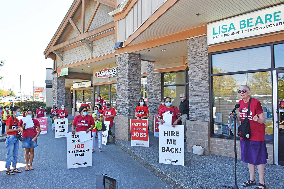Laid off hotel workers demonstrate outside the office of Tourism Minister Lisa Beare in Maple Ridge on Aug. 27, 2020. At the mic is Vancouver city Coun. Jean Swanson. (Neil Corbett/The News)