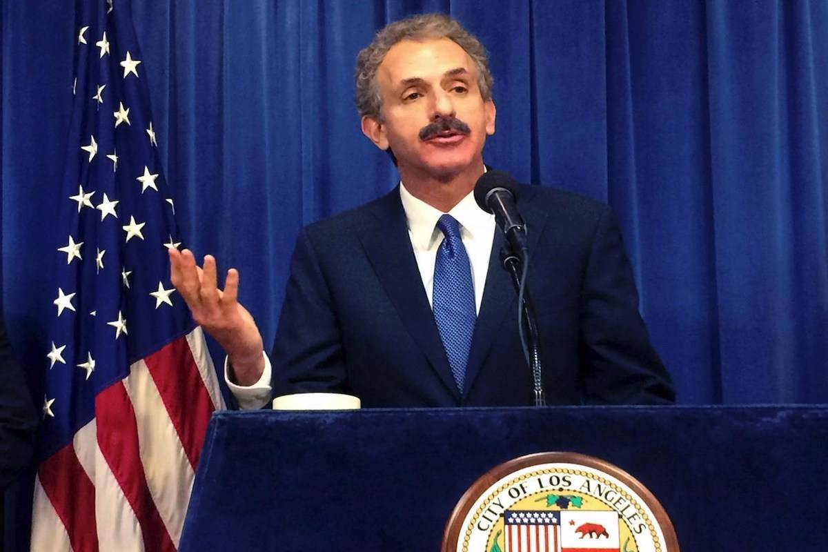 FILE - In this June 20, 2017, file photo, Los Angeles City Attorney Mike Feuer talks during a news conference in Los Angeles. Feuer's office filed misdemeanor charges against TikTok celebrities Bryce Hall and Blake Gray after they hosted recent parties in the Hollywood Hills despite the city's ban on large gatherings during the coronavirus pandemic, authorities said Friday, Aug. 28, 2020. Feuer said he is not aware of any COVID-19 cases that have been linked to their parties. (AP Photo/Christopher Weber, File)