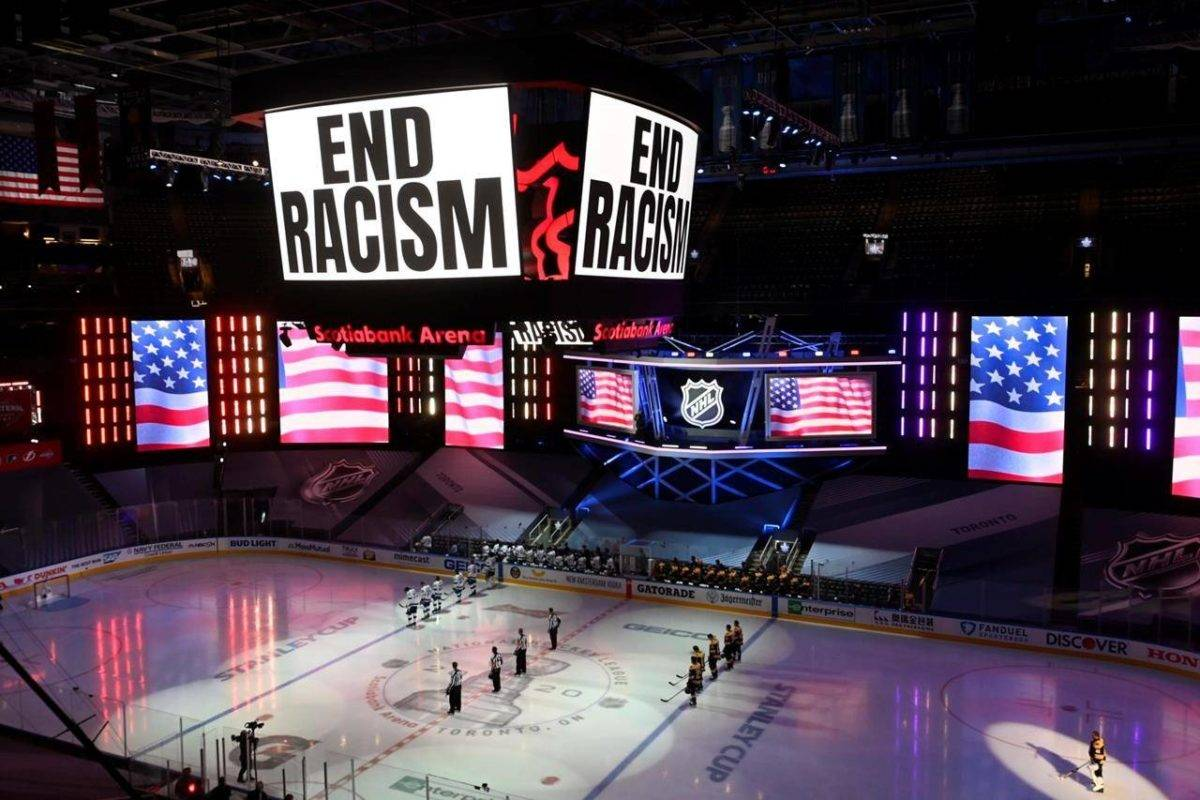 An End Racism message is displayed before the start of the first period NHL Stanley Cup Eastern Conference playoff hockey action as Boston Bruins play Tampa Bay Lightning in Toronto, Wednesday, Aug. 26, 2020. THE CANADIAN PRESS/Frank Gunn