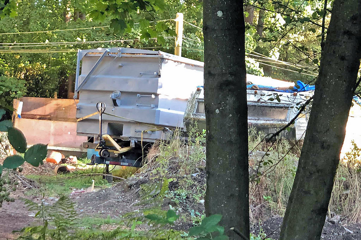Brookswood resident Shannon Donaldson posted this image of the clutter next door on social media. (Shannon Donaldson/Special to Langley Advance Times)