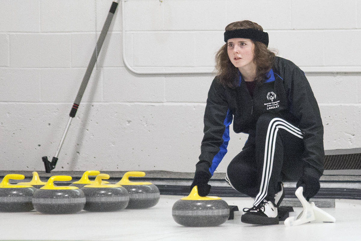 Jennifer McCabe of Langley prepared to take a shot at the Special Olympics bonspiel held at the Langley Centre in 2018. When play resumes, likely in October, people will be expected to keep a safe distance.(Langley Advance Times file)