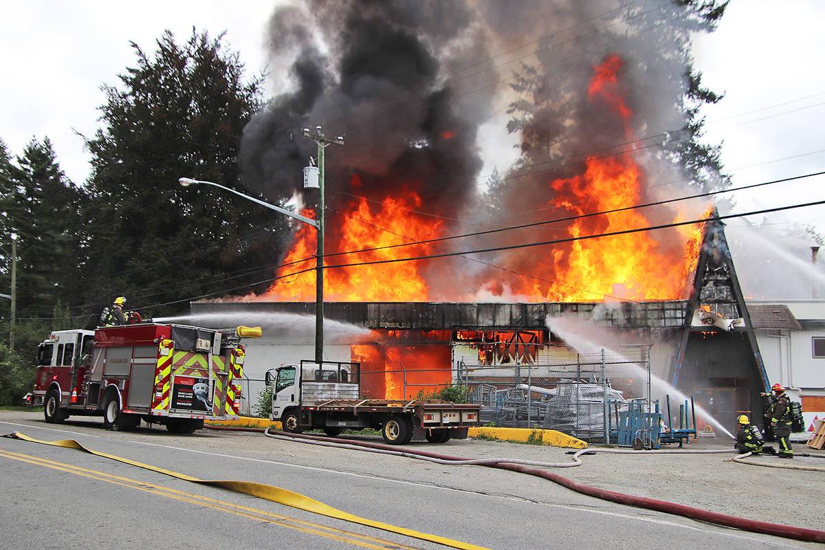 Surrey firefighters battle a two-alarm blaze at Ace Building Centre in Port Kells Aug. 31. (Photo: Shane MacKichan)