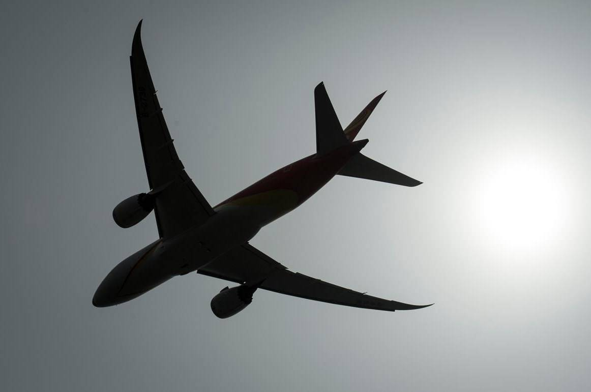 A plane is silhouetted as it takes off from Vancouver International Airport in Richmond, B.C., Monday, May 13, 2019. The Canadian Transportation Agency says it has received more than 8,000 complaints about airlines since mid-March, an unprecedented figure for the five-and-a-half-month period. THE CANADIAN PRESS/Jonathan Hayward