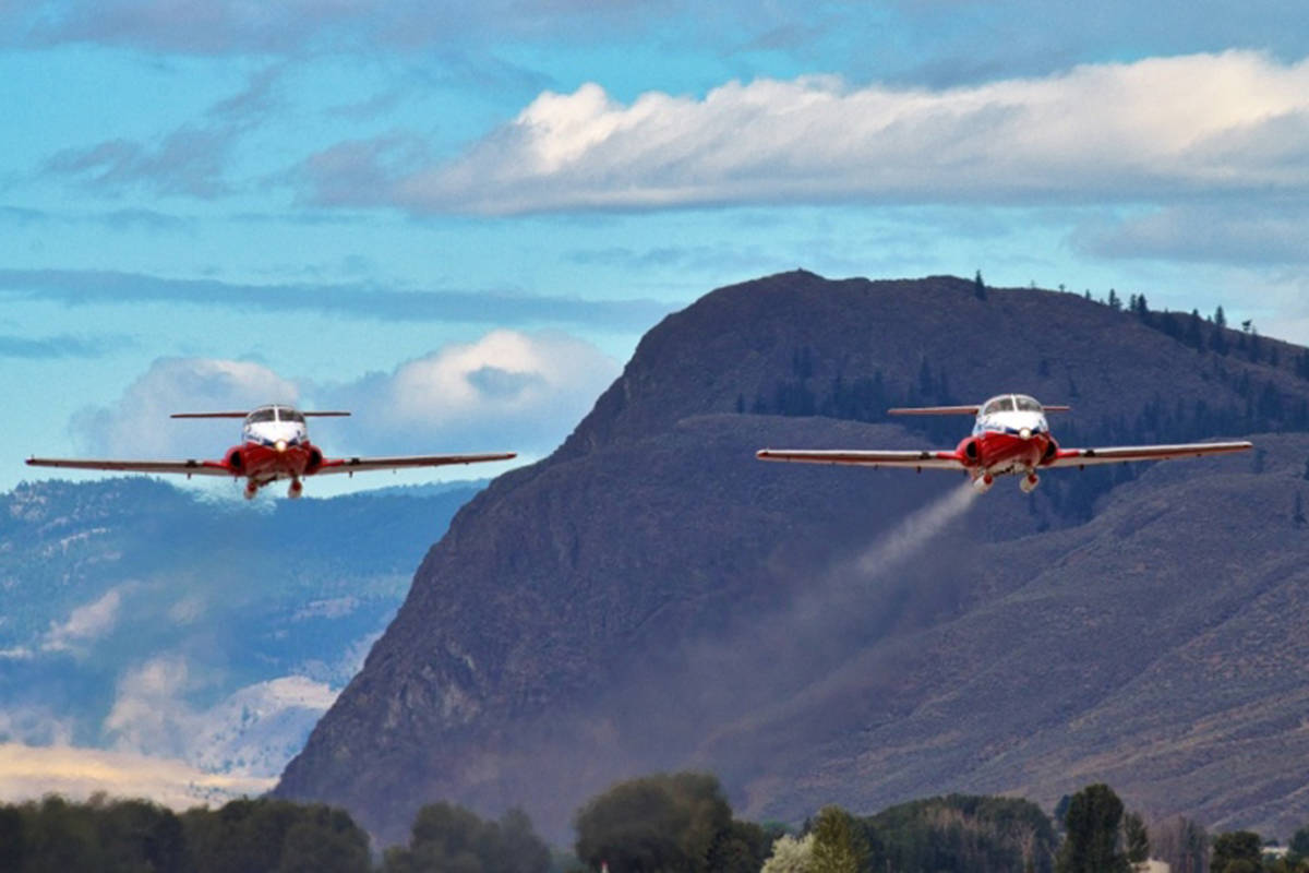 A pair of Canadian Forces Snowbirds CT-114 Tutor jets take off from Kamloops Airport on Tuesday morning. It marked the first time the iconic red ad white jets have been airborne since the May 17 crash in Kamloops that claimed the life of Capt. Jennifer Casey and injured the pilot, Capt. Richard MacDougall. The rest of the squadron's planes will be flown to home base in Moose Jaw later this month. (Dave Eagles/KTW)