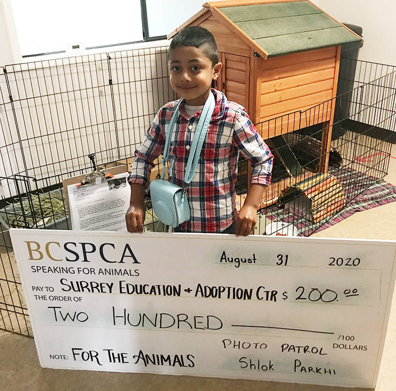 Shlok Parkhi, 5, raised $200 for the BCSPCA by taking, and selling, pictures of people with their pets. (Contributed photo)