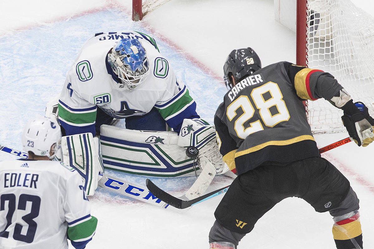 Vancouver Canucks goalie Thatcher Demko (35) makes the save on Vegas Golden Knights' William Carrier (28) during third period NHL Western Conference Stanley Cup playoff action in Edmonton on Tuesday, Sept. 1, 2020. THE CANADIAN PRESS/Jason Franson