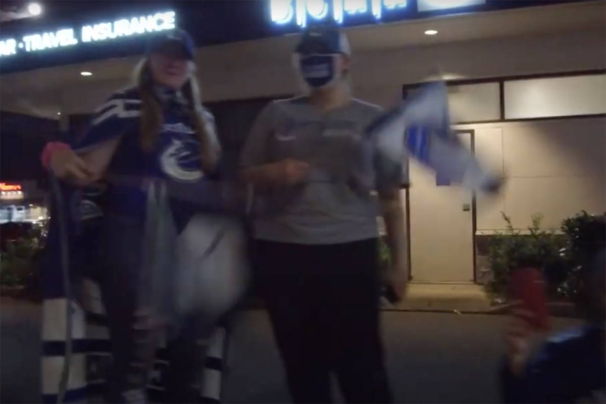 Vancouver Canucks fans in Abbotsford on South Fraser Way celebrate the club's game five win on Tuesday. (YouTube)