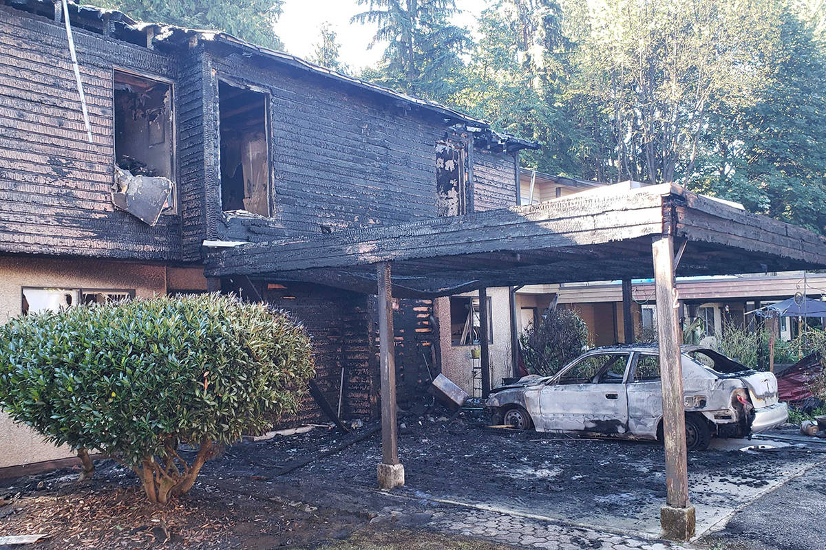 Maple Ridge fire department responded to two townhouses on fire at 207 Street and Dewdney Trunk Road in the early hours of Thursday, Sept. 3, 2020. (Neil Corbett/The News)
