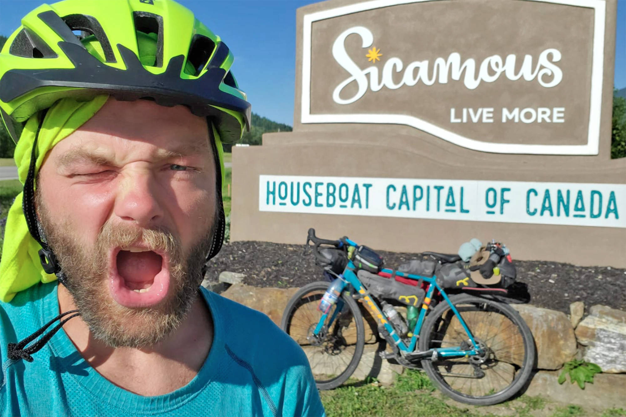 Marco Bieri poses by his bicycle in Sicamous following a five-day ride, done largely over trails and backroads, from Vancouver between July 24 and 29, 2020. (Contributed)