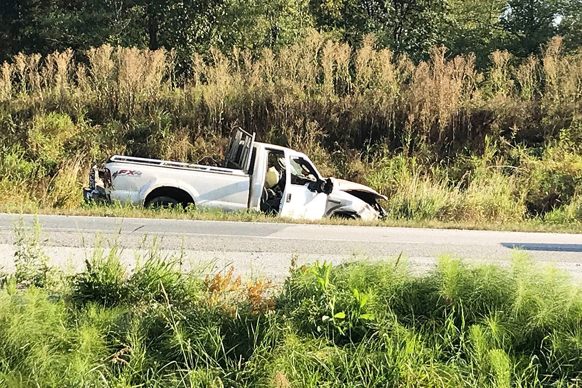 A pick-up truck was seen in a ditch at the sight of a crash on Hwy 1 and Glover Road in Langley this morning. (Special to THE TIMES)