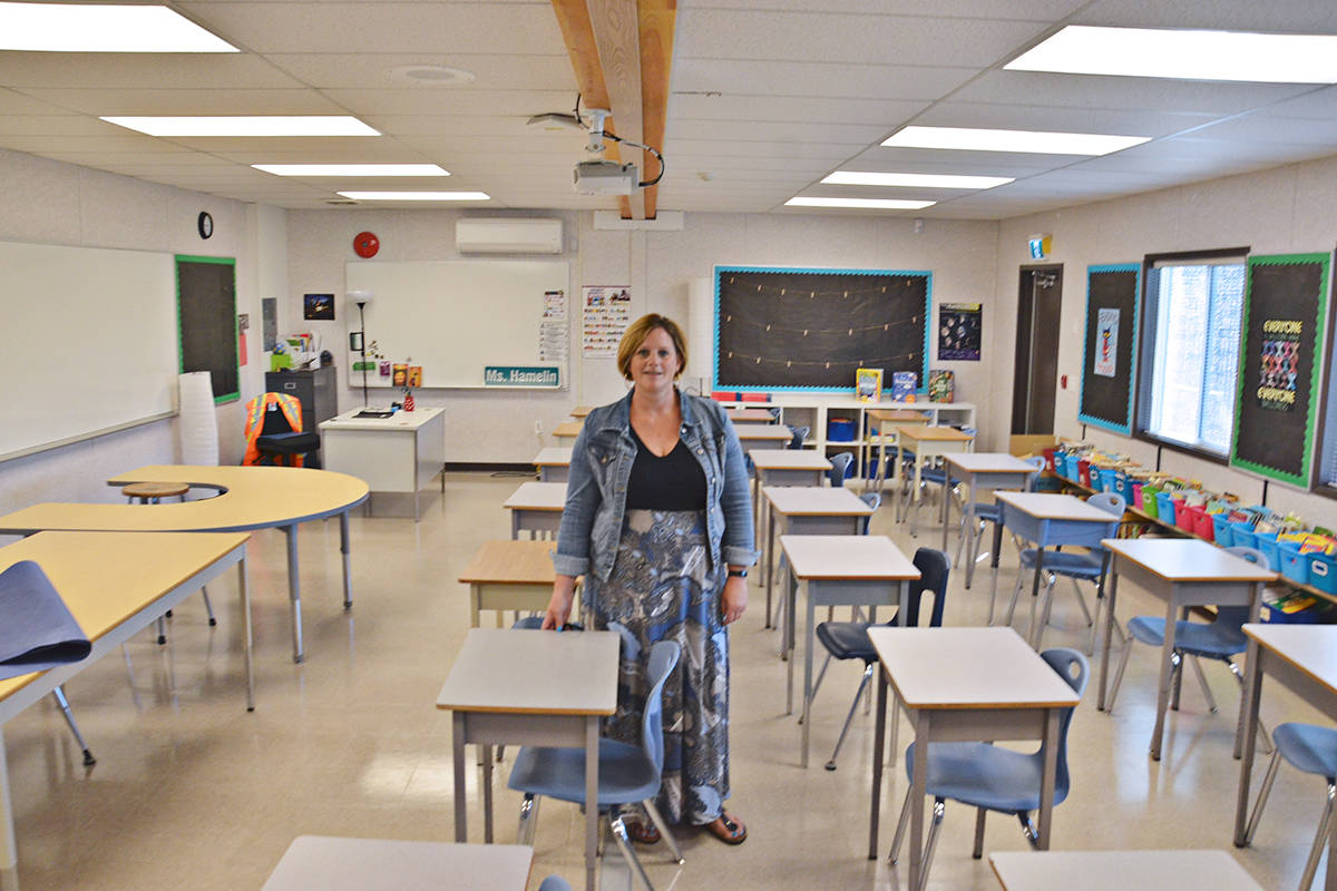 Principal Kim Anderson shows the set up of one of the four school portable classrooms at Lynn Fripps Elementary. (Heather Colpitts/Langley Advance Times)
