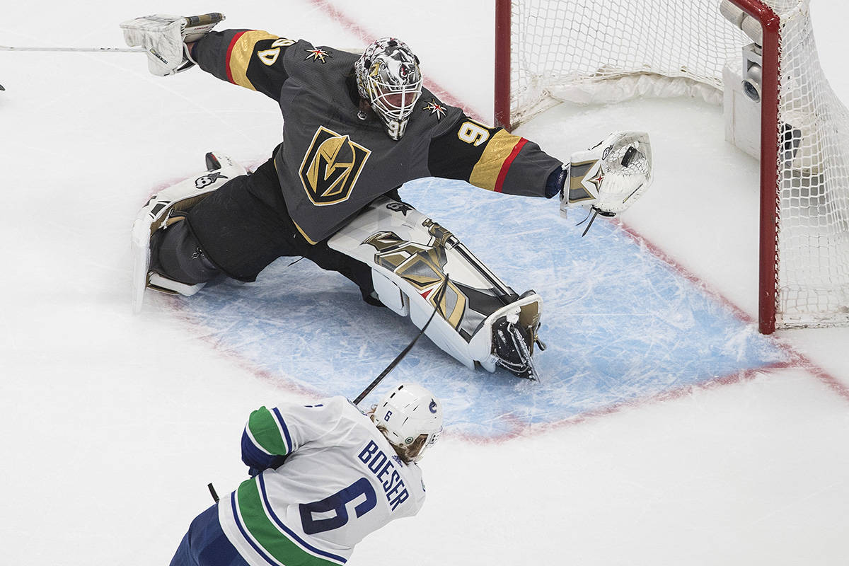 Vancouver Canucks' Brock Boeser (6) is stopped by Vegas Golden Knights goalie Robin Lehner (90) during second period NHL Western Conference Stanley Cup playoff action in Edmonton on Friday, Sept. 4, 2020. THE CANADIAN PRESS/Jason Franson