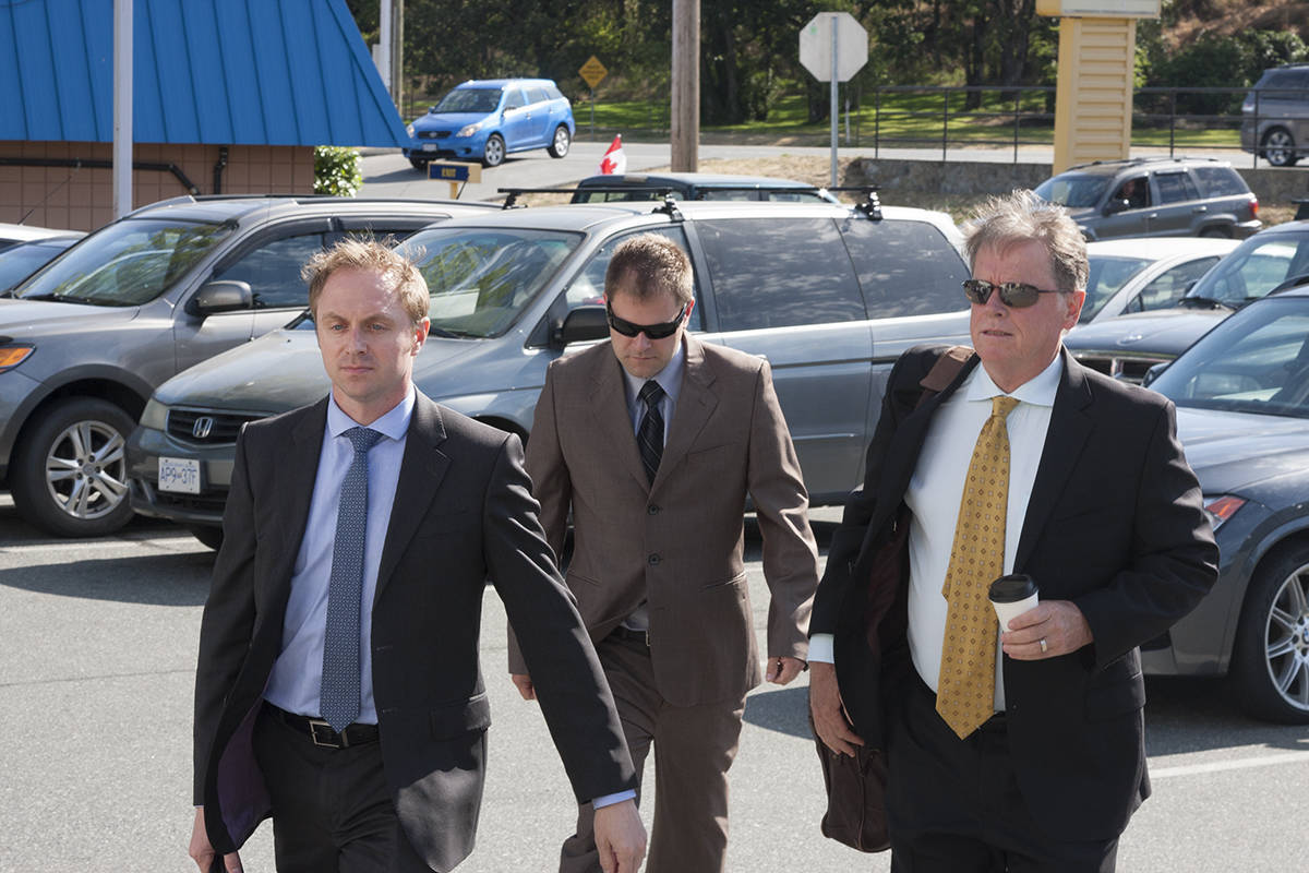 Kenneth Jacob Fenton, in 2017, flanked by his lawyers Chris Masey and Dale Marshall during his sentencing hearing for charges that stemmed from the crash that led to the death of RCMP officer Const. Sarah Beckett. (Black Press Media file photo)