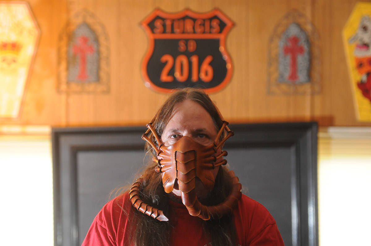 Owen Chester handmade this 'facehugger' mask out of leather. He's pictured at his Chilliwack home on Sept. 2, 2020. (Jenna Hauck/ Chilliwack Progress)